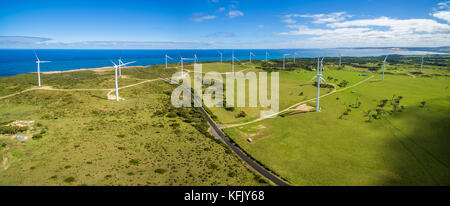 Aerial panorama of rural road and wind farm in Australia - Stock Photo