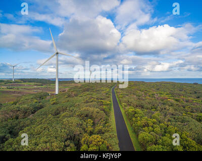 Aerial view of wind turbines and rural road in Australia - Stock Photo