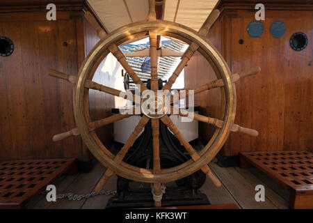 Ship's wheel on the Discovery ship berthed at Discovery Point  in Dundee ,Tayside, Scotland, - Stock Photo