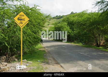 Crocodile crossing sign on the road from Dili to Baucau, Timor-Leste (East Timor). Saltwater crocodiles, Crocodylus - Stock Photo