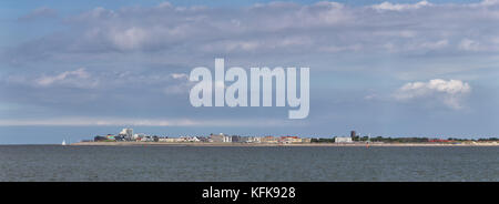 View from the north sea island Juist towards the west coast of Norderney in East Frisia, Germany, Europe. - Stock Photo