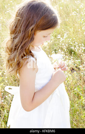 Little girl with flower - Stock Photo