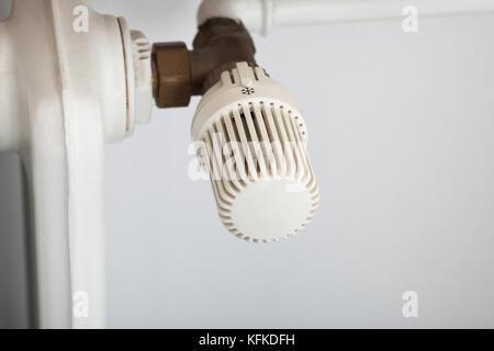 Closeup photo of temperature control on radiator - Stock Photo