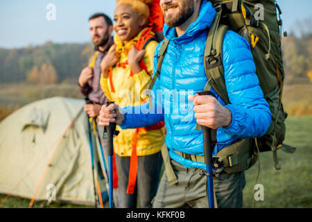 Hikers with backpacks outdoors - Stock Photo