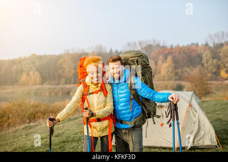 Couple hiking with backpacks - Stock Photo