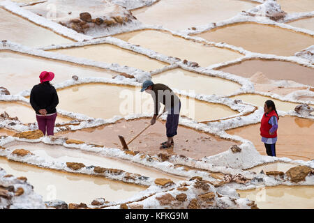 Workers in the salt mines of Maras, Sacred Valley of the Incas, Province of Cusco, Peru - Stock Photo