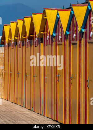 Yellow painted wooden bathing huts at Peter's Beach. A private beach in Sorrento. Italy - Stock Photo