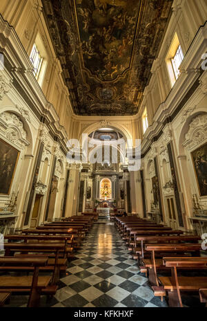 Interior aisle and wooden pews of Santuario Della Madonna Del Carmine, Piazza Tasso, Sorrento, Italy.