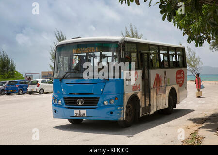 The Seychelles, Praslin, Baie St Anne, Mount Plaisir bus at jetty bus stop - Stock Photo