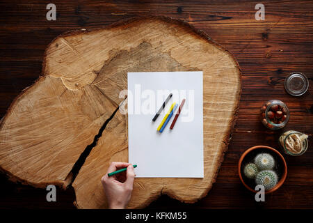 drawing on tree pit creative atmosphere Stock Photo