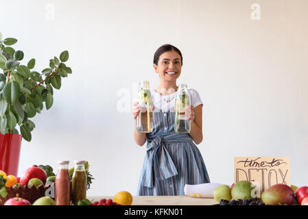 woman with detox drinks - Stock Photo