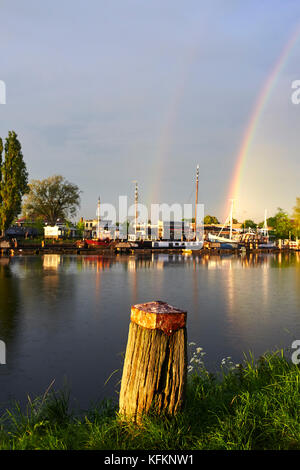 bollard with rainbow on channel in amsterdam netherlands - Stock Photo