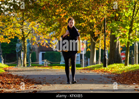 Dorchester, Dorset, UK. 30th Oct, 2017. UK Weather. A Pedestrian wearing a coat and a scalf to keep warm, walks - Stock Photo