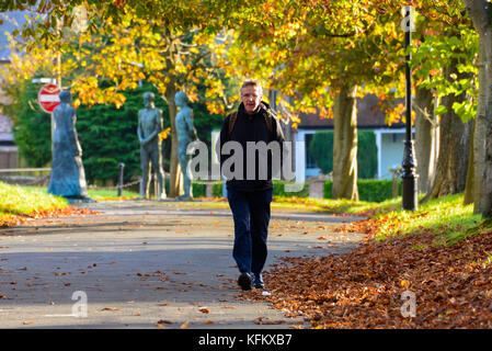 Dorchester, Dorset, UK. 30th Oct, 2017. UK Weather. A Pedestrian wearing a coat to keep warm, walks along South - Stock Photo