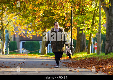 Dorchester, Dorset, UK. 30th Oct, 2017. UK Weather. A Pedestrian wearing a thick coat to keep warm, walks along - Stock Photo