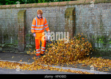 Dorchester, Dorset, UK. 30th Oct, 2017. UK Weather. A council worker blowing fallen leaves from the pavement on - Stock Photo