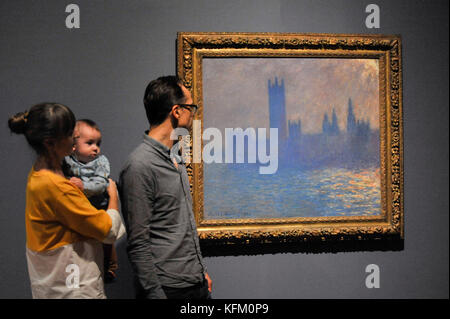 London, UK. 30th Oct, 2017. Visitors view 'Houses of Parliament, Sunlight Effect', 1903, by Claude Monet at a preview - Stock Photo