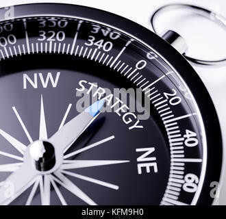 Compass with the needle pointing the word strategy. 3d rendering illustration with depth of field blur effect. Concept - Stock Photo
