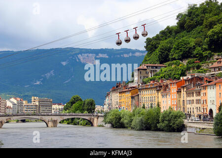 Isere river and cable car in the center of Grenoble, France - Stock Photo