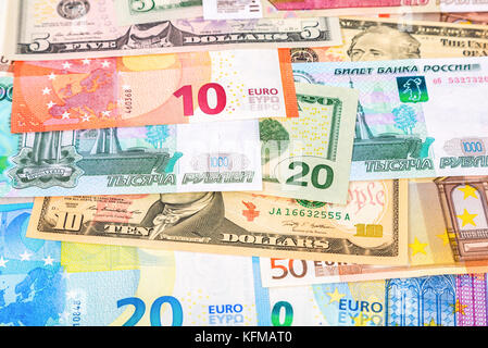 Money background from banknotes euro, american dollars and russian rubles - Stock Photo