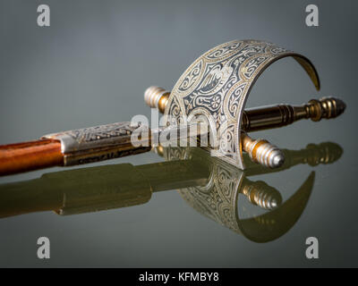 Closeup of an old spanish paper knife with beautiful ornaments on the handle - Stock Photo