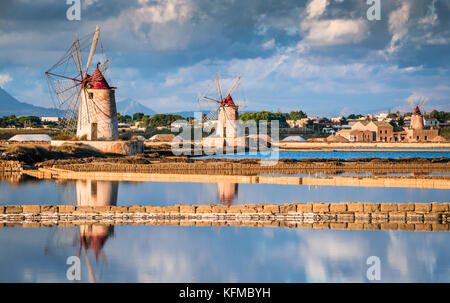 Marsala, Italy. Stagnone Lagoon with vintage windmills and saltwork, Trapani province, Sicily. - Stock Photo