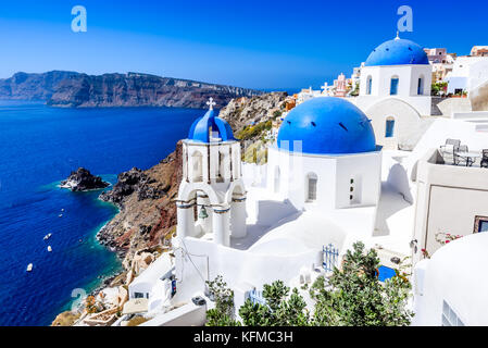 Oia, Santorini, Greece. Famous attraction of white village with cobbled streets, Greek Cyclades Islands, Aegean - Stock Photo