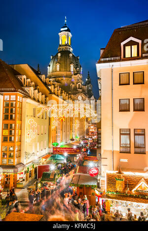DRESDEN, GERMANY -  17 DECEMBER 2016: Dresden with people visit Weihnachtsmarkt and der Frauenkirche in Germany. - Stock Photo