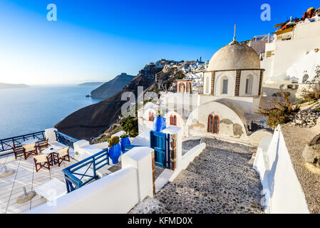 Santorini, Greece. Fira, with old greek church and caldera at Aegean Sea, Thira. - Stock Photo