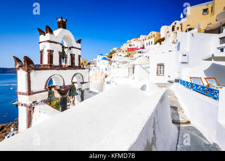 Oia, Santorini - Greece. Famous attraction of white village with cobbled streets, Greek Cyclades Islands, Aegean - Stock Photo