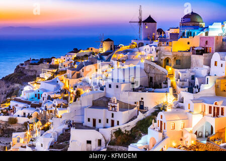 Oia, Santorini - Greece. Idyllic attraction of white village with cobbled streets and windmills, Greek Islands of - Stock Photo