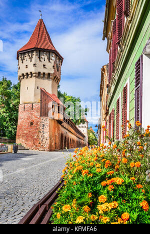 Sibiu, Romania - Medieval downtown of the largest saxon city in Transylvania. Carpenters Tower. - Stock Photo