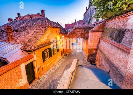Sibiu, Romania - Passage of the Stairs and the Lutheran Cathedral at twilight. Transylvania saxon city. - Stock Photo