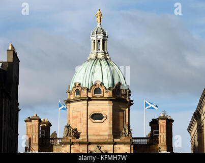 Flags fly from the top of the Bank of Scotland headquarters on the Mound, Edinburgh. - Stock Photo