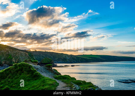 Wide angle photograph encompassing Cornwalls idyllic Polkerris Harbour at the break of Dawn. - Stock Photo