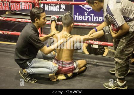 Massage, Boy, Muay Thai boxer before the fight starts, Bangkok, Thailand - Stock Photo