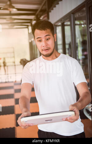 Shocked because of excessive or overweight - Stock Photo