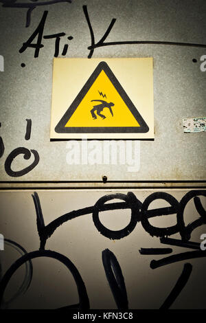 Yellow hazard warning triangle , electric signal danger. - Stock Photo