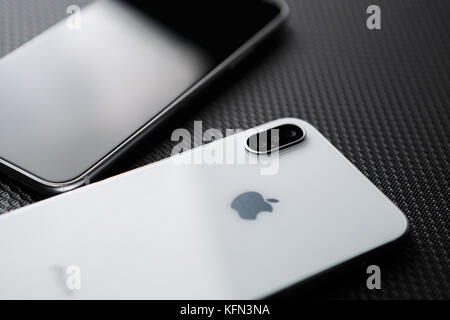 MARIUPOL,UKRAINE - 27 OCTOBER,2017: New Iphone X model close up.Modern mobile phone with touch screen and dual camera - Stock Photo