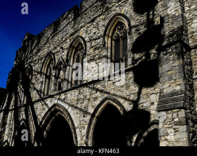 The Bargate in Southampton with the shadows of a near by ferris wheel across the stone work.The Bargate is a medieval - Stock Photo