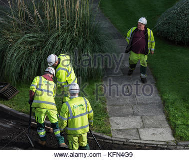 A Conway roadworks crew laying down new asphalt on a road in London. - Stock Photo