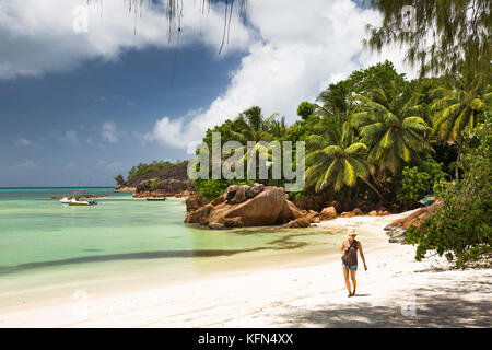 The Seychelles, Praslin, Anse Volbert, tourist on Cote d'Or beach at Anse Gouvernment - Stock Photo