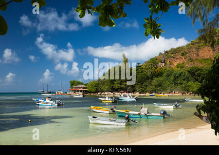 The Seychelles, Praslin, Anse Posession, beach, leisure boats moored in shallow lagoon - Stock Photo