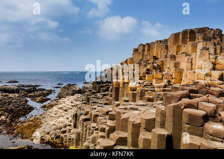 The Giants Causeway in County Antrim of Northern Ireland is declared a World Heritage Site by UNESCO containing - Stock Photo