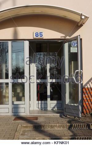 POZNAN, POLAND - APRIL 10, 2015: Open entrance doors of a apartment building - Stock Photo