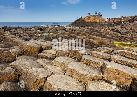 Thousands of tourists visiting Giant's Causeway in County Antrim of Northern Ireland, a World Heritage Site by UNESCO - Stock Photo