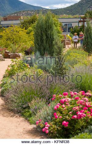 ... Two Women Walking On Path In The Meadow Garden Area Of The Santa Fe  Botanical Garden