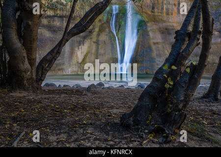 A short hike near Boulder, Utah leads to this gorgeous waterfall. - Stock Photo