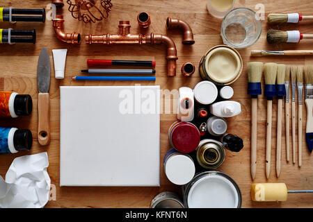 blank canvas in creative chaos - Stock Photo