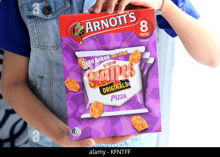 A box of Arnott's Oven Baked Shapes Originals Pizza crackers - Stock Photo